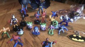 Photo Different action figures Batman, Spiderman, Superman, cat woman, Iron man, flash, Aquaman, thorn, The hulk, Lex Luther, captain America, and joker