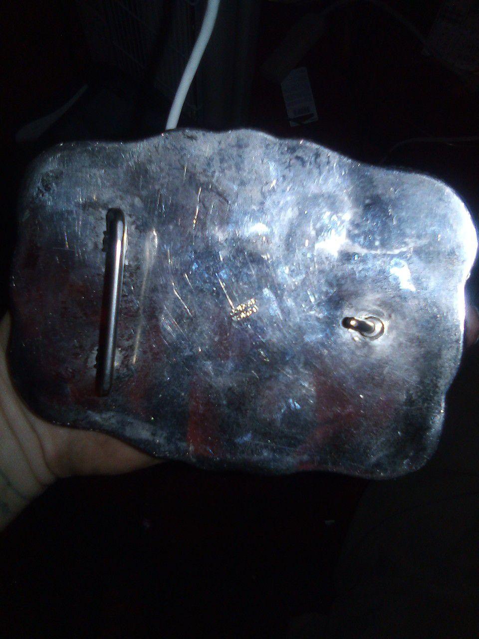 Silver rodeo belt buckle
