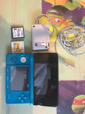 Nintendo 3DS plus charger and 2 games. for Sale in Silver Spring, MD