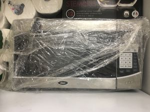 Oster stainless steel microwave for Sale in Houston, TX