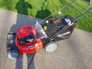 Photo New never used Craftsman self-propelled lawn mower rear wheel drive