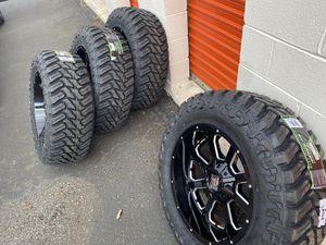 "Photo 20x10 xd buck wheels and 35"" mud tires"
