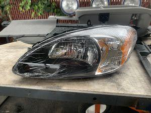 Photo 2000 / 2007 Ford Taurus headlight brand new in box