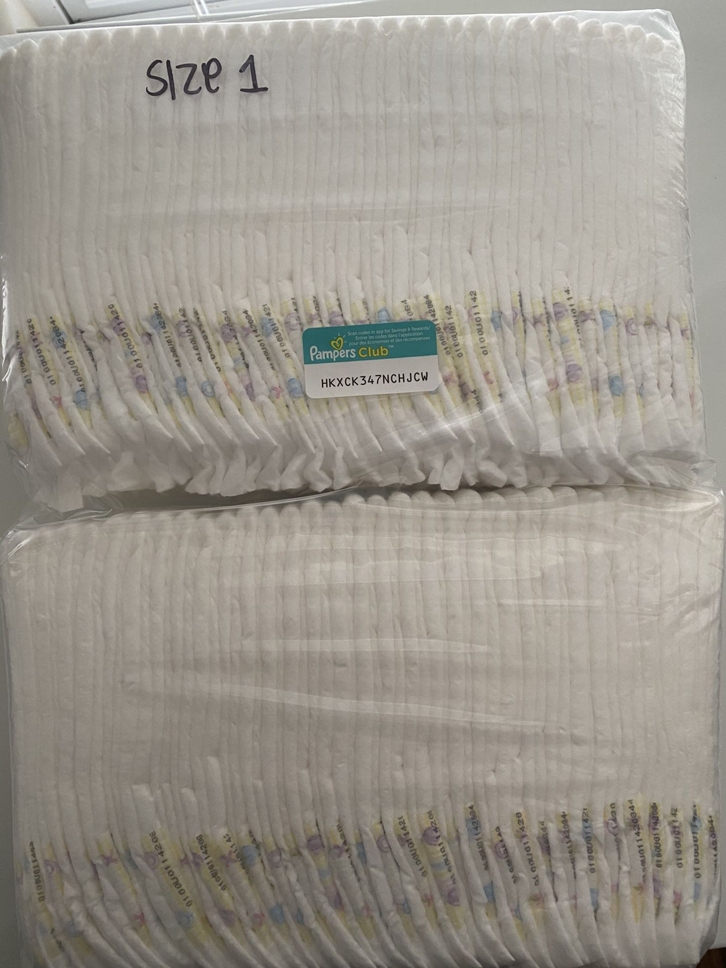 Size 1 pampers swaddlers - 66 diapers