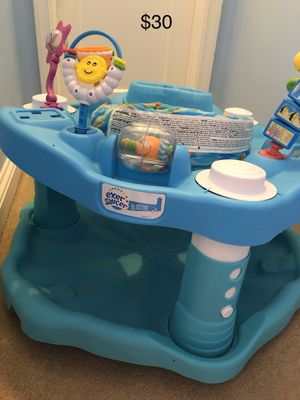 Photo Fisher price excersaucer activity center