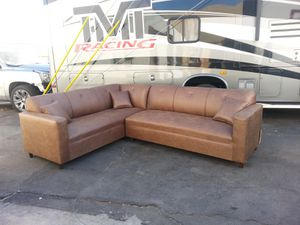 Photo NEW 7X9FT CAMEL LEATHER SECTIONAL COUCHES