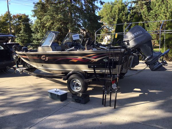 2008 angler v172 g3 boat with 2 tackle boxes and 4 fishing rods
