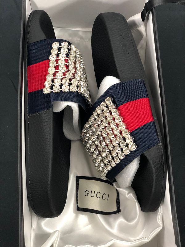 5a1420e3f70 Gucci Crystal embellished leather and rubber Black slides