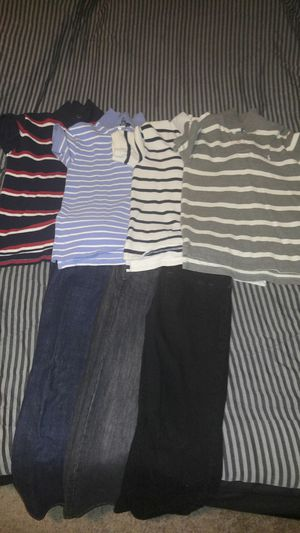 4 polo shirts and 3 pants for Sale in Oxon Hill, MD