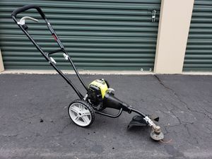 Photo Ryobi High Wheeled Gas Weed Trimmer Mower 4 cycle engine PRICE IS FIRM