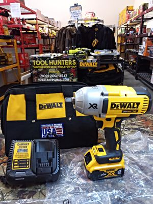 Photo ABSOLUTELY BRAND NEW!! DEWALT 20 VOLT MAX XR BRUSHLESS 1/2 HIGH TORQUE IMPACT WRENCH KIT WITH A 4 AH BATTERY AND CHARGER WITH BAG!!