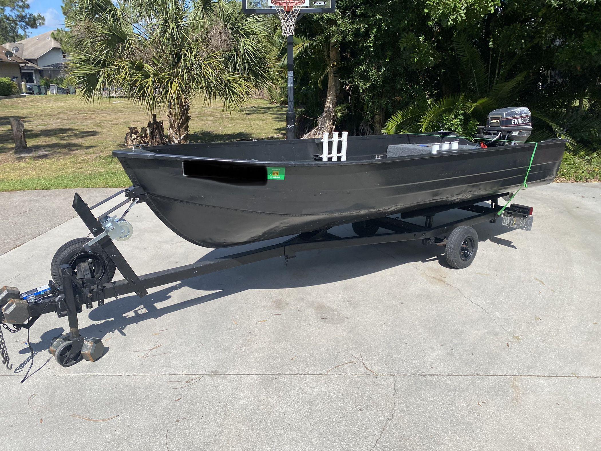 Photo 14 foot jon boat with 40 horse johnson