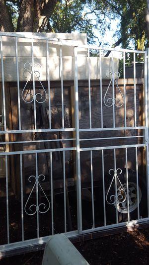 puerta de hierro 6 piez ancho 82 pulgadas alto for Sale in Tampa, FL