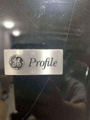 Photo Black GE profile fridge/freezer