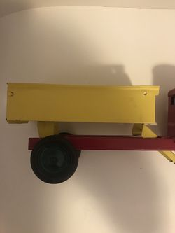 Vintage and Rare Turner Toys Pressed Metal Red and Yellow Dump Truck with Battery Slot for Working Headlights 18in Length 6in Height Normal Wear Rubb Thumbnail