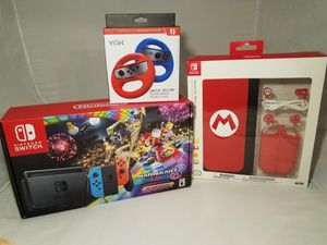 Brand new Nintendo Switch Mario Kart bundle.With accesories and 2 wheels. Everything Brand new. Great gift. for Sale in Orlando, FL