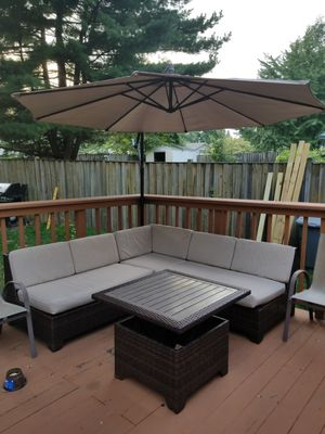 Ashley's Furniture sectional outdoor sofa with retracting umbrella for Sale in Rockville, MD