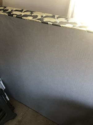 """Photo Brand new queen box spring. Won't fit down the basement stairs. 58"""" x 79"""""""