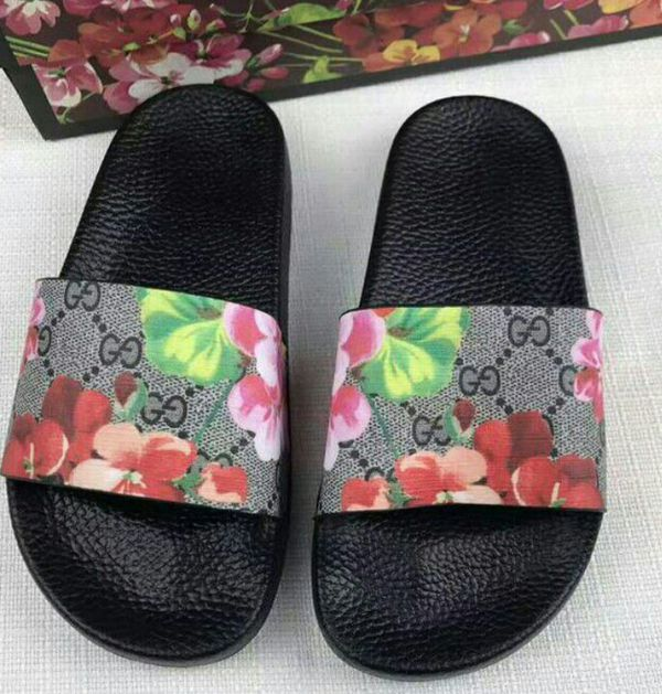 bb73aadb281b Gucci  011 Women s GG Signature with Pink Flowers Supreme slide sandal.