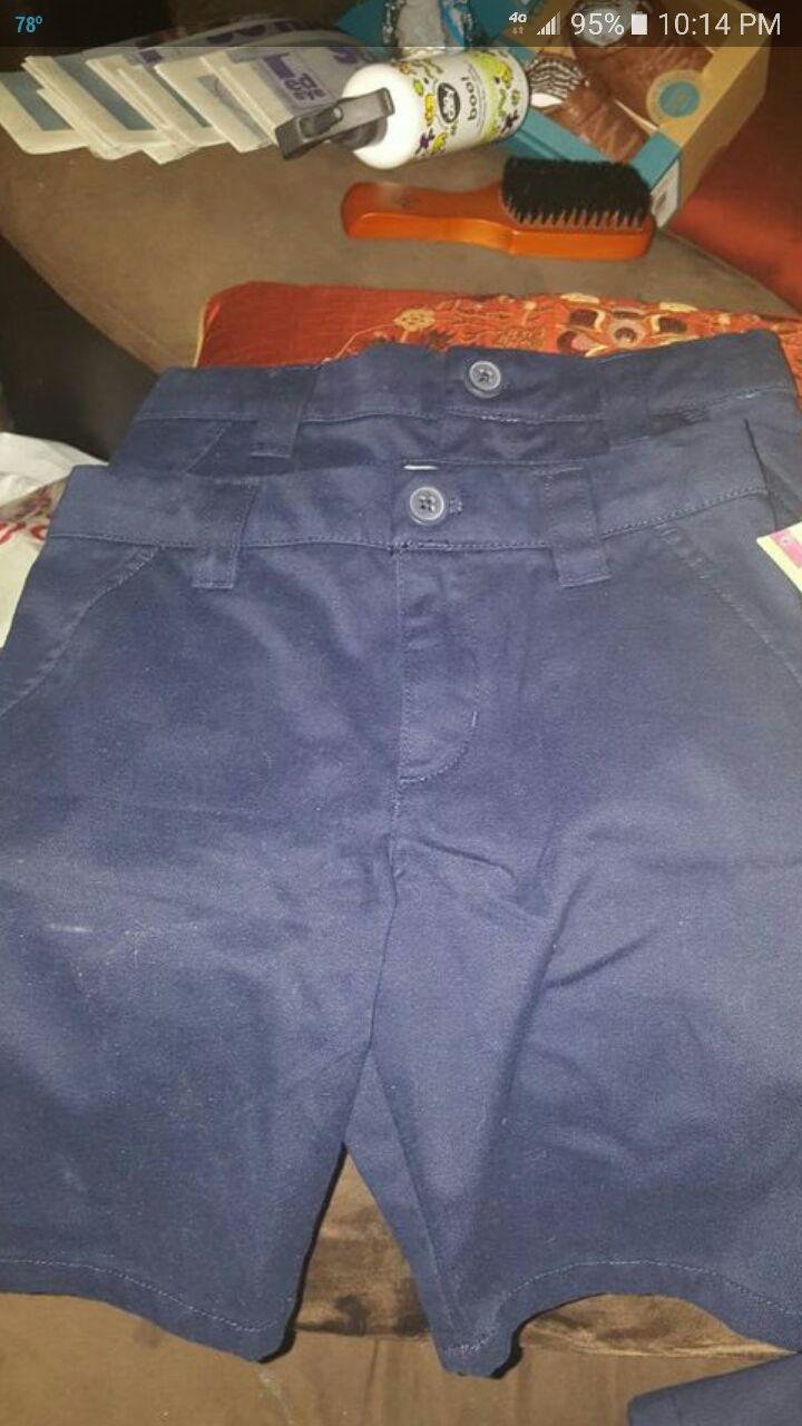 Blue uniform shorts and skirt