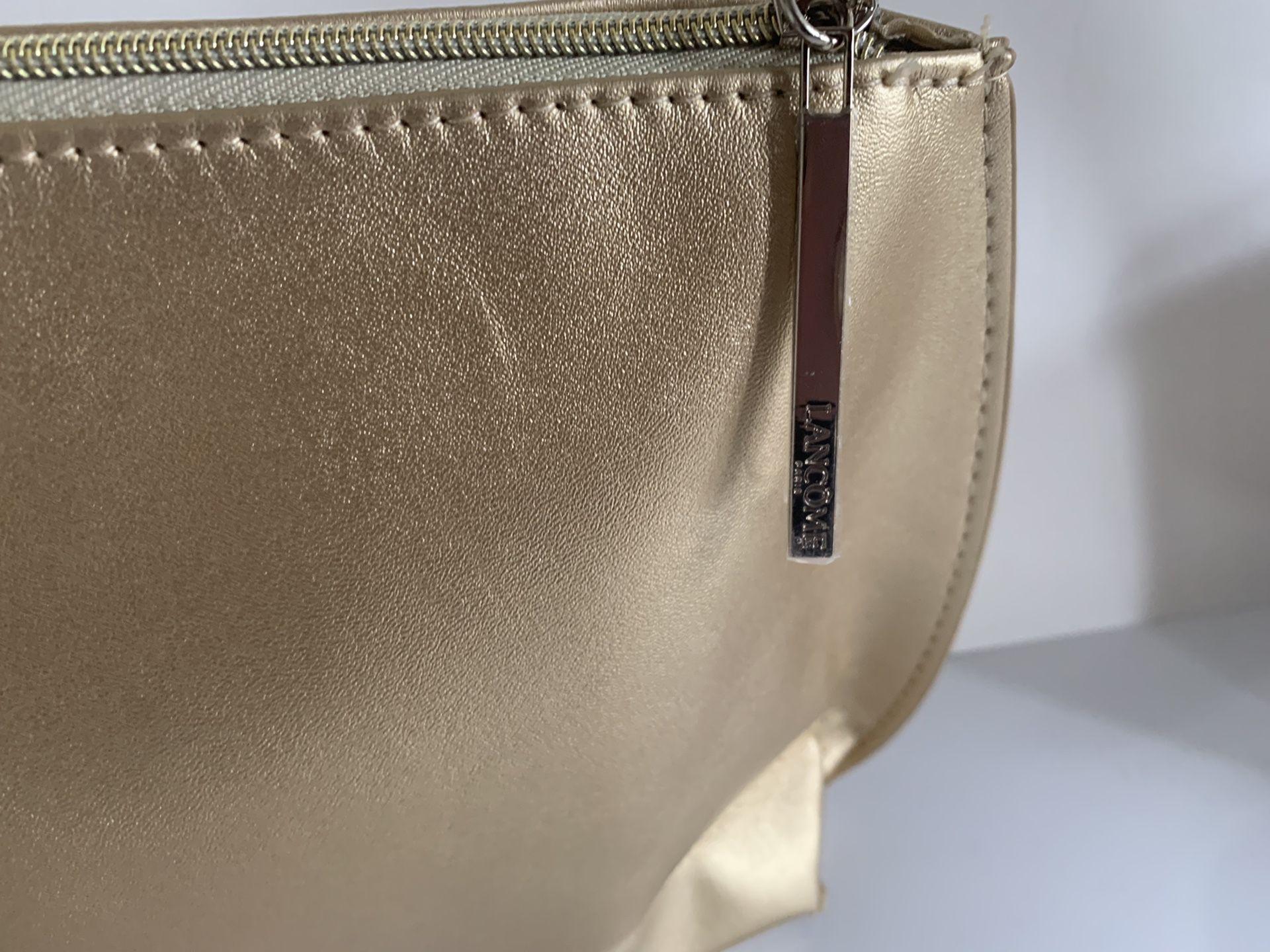 """Lancôme Paris gold color gorgeous cosmetic bag. 12""""X 6.5""""and 2.5"""""""