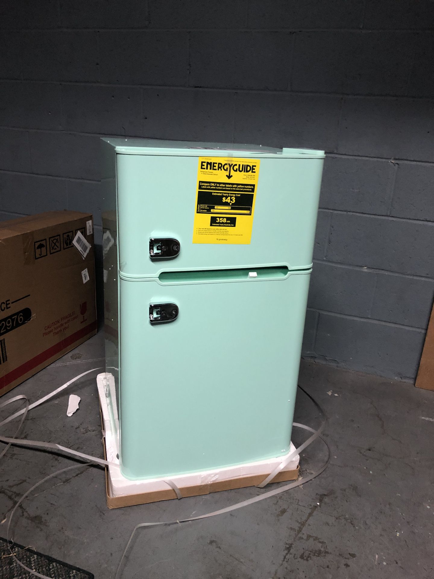Compact Mini Refrigerator with Separate Freezer in the box with small dent on one side