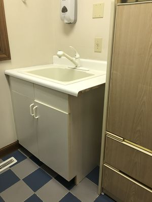 Photo Laundry/utility sink with cabinet