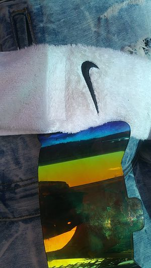 6583f56dd4a195 Rainbow mirror visor + nike towel for Sale in Richmond