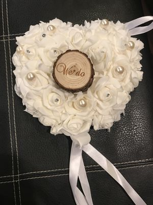 White foam rose wedding ring barer pillow with log in the middle. for Sale in Rockville, MD