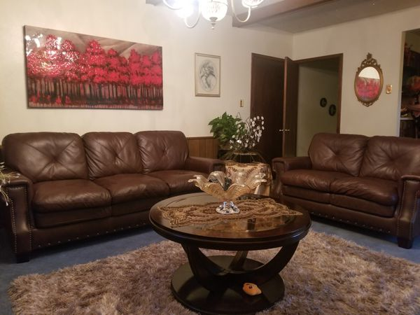 Brown leather couch set living room set with minor tear on the back ...