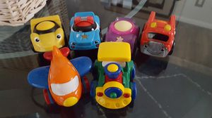 Photo Toddler cars/ 4 roller balls in them