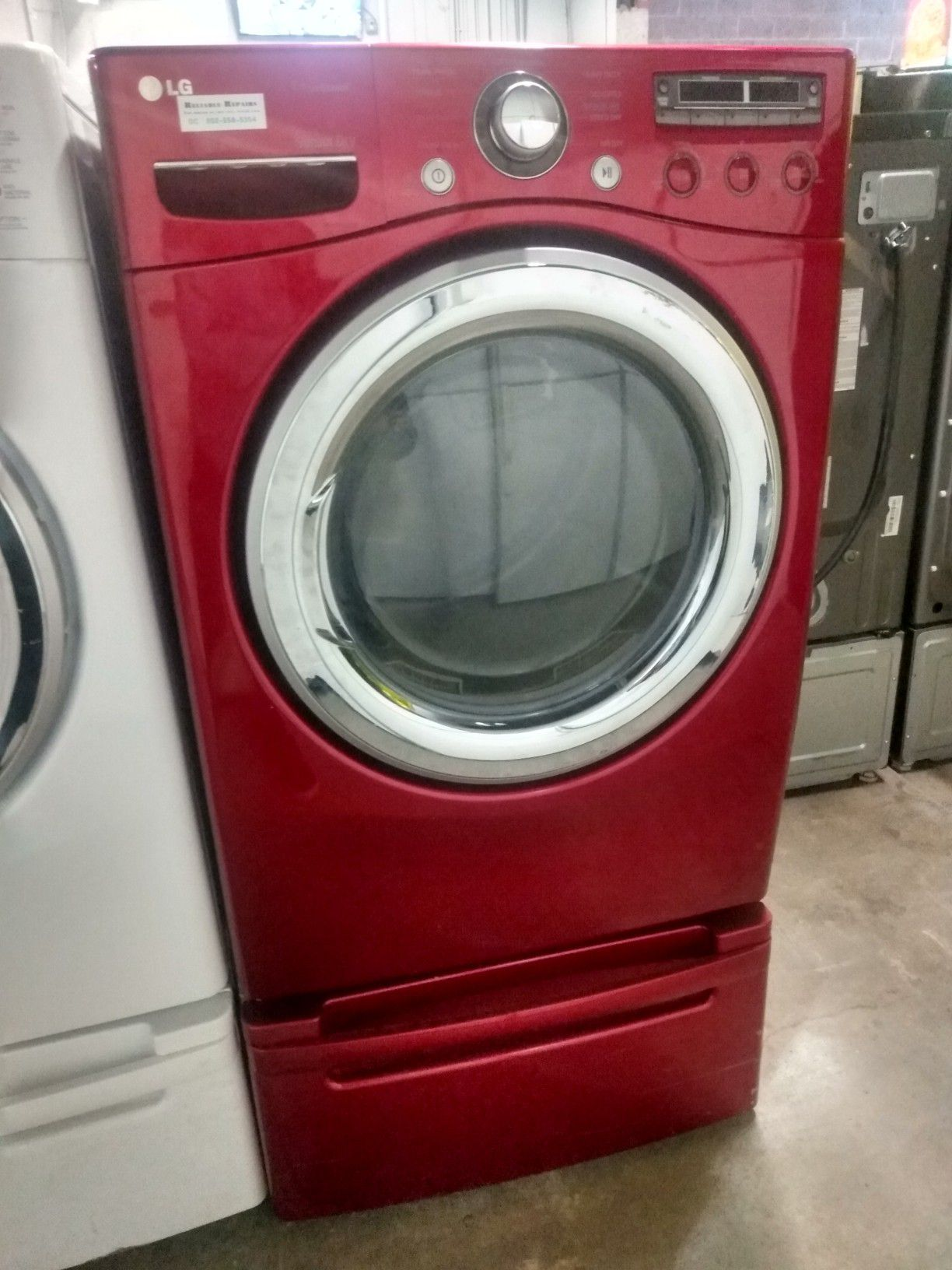 LG front load steam electric dryer with pedestal in excellent condition