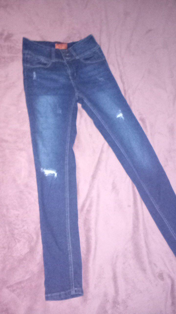 New never worn. Size 5 wax butt jeans