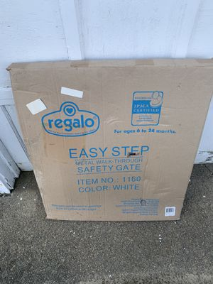 Photo New never used baby safety gate easy step - two total