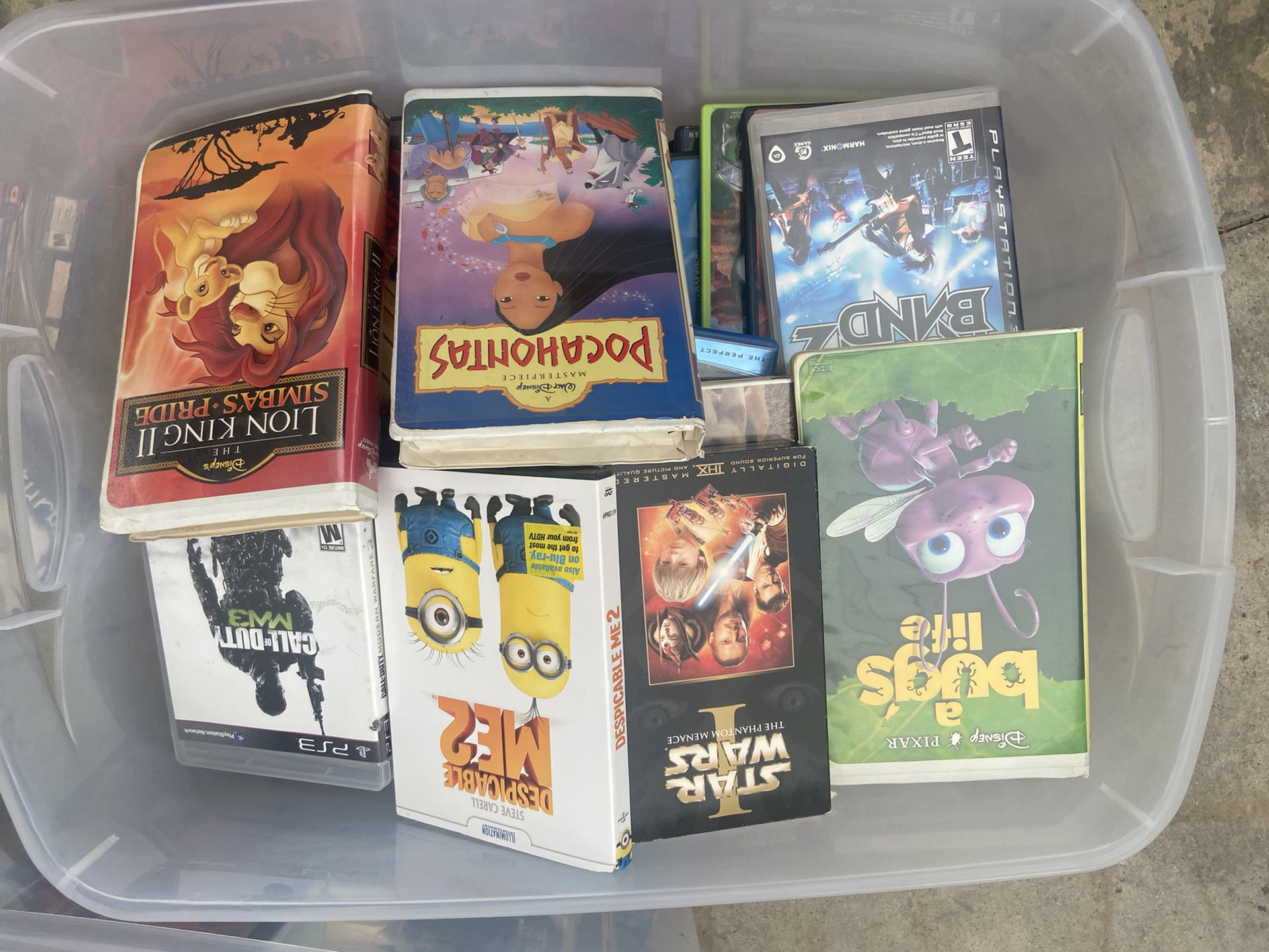 VHS tapes, DVDs, Blu-ray, PlayStation games rock band games