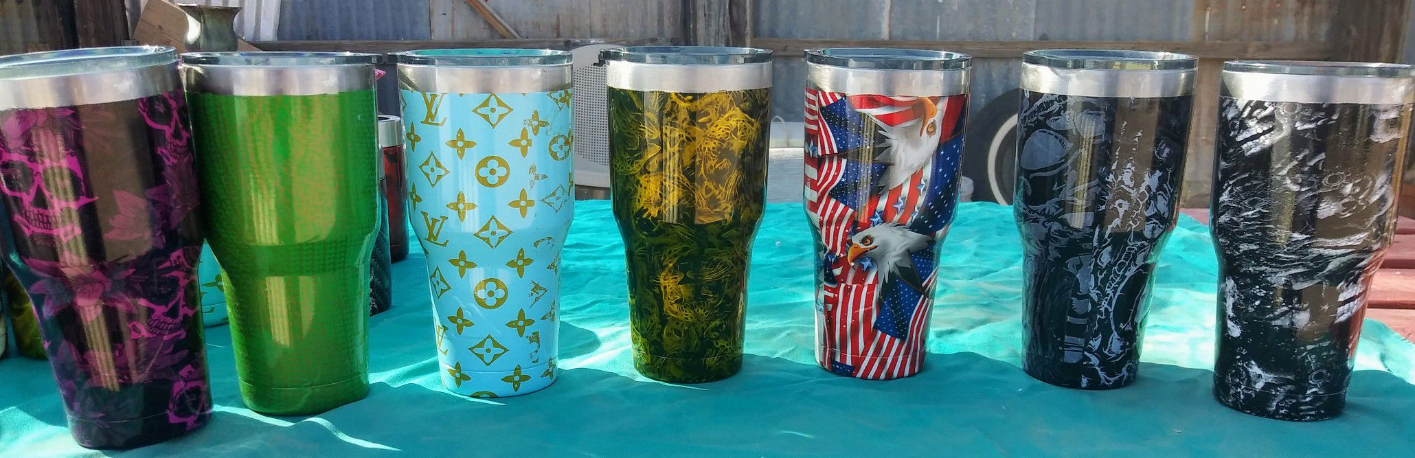 Cups for hot or cold item's Hydro dip painting on outside. Small one's hold a can for soda or beer other items can be painted as well.
