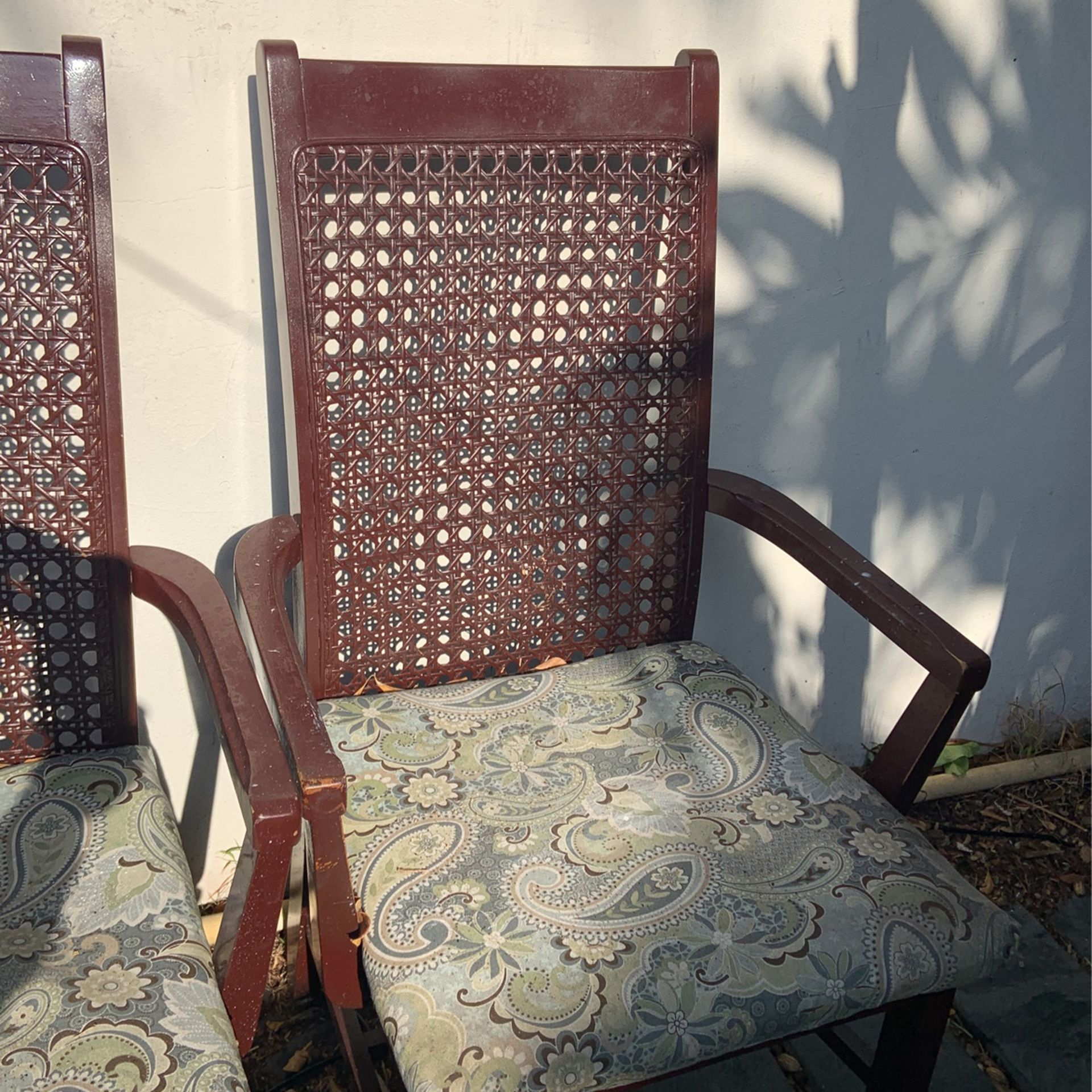 Solid wood, two Arm Cane Chairs From The 70's...chairs need restoring...cane In Good Condition