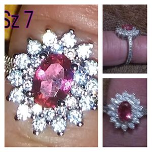 Beautiful Sterling silver ring with a Ruby center surrounded by white cz diamonds. for Sale in Glen Burnie, MD