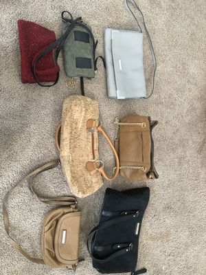New and almost new Purses. There are two Michael Kors,tan $30, taupe $40. a red Carlisle, $45 for Sale in Huntington Beach, CA