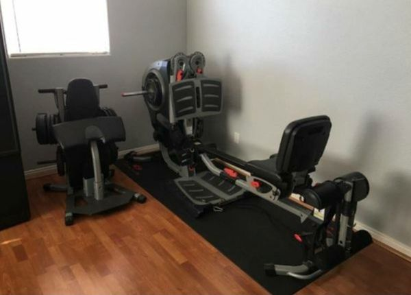 Bowflex revolution home gym all in one with accessories and rack