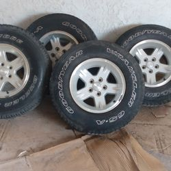 5 Stock Jeep 15-in Rims And Tires Wrangler Tires Used In Good Condition Thumbnail