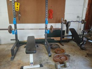 Photo Weight bench with pull up bar vertical bench, 335lbs of Olympic weights and one dumbell that is 65lbs