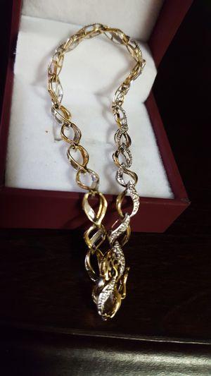 Photo Precious 10k Real Gold Bracelet 4.52g Size 7.5inches length, gorgeous 10k Real Gold Bracelet. Two tones gold.