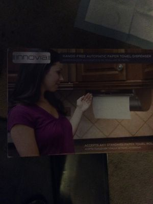 Photo NEW IN BOX, NEVER USED. INNOVIA HANDS FREE AUTOMATIC PAPER TOWEL DISPENSER. SELLS FOR $141.