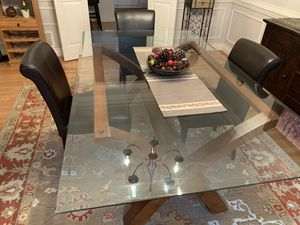 Photo Glass top dining room table. Seats 6