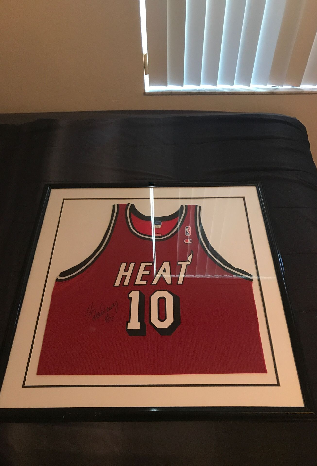 "Autographed ""Tim Hardaway"" Heat Jersey"