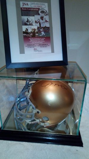 Photo JOE Montana sighned notra Dame fighting Irish riddle mini helmet in mirrored display case with JSA certificate of authinticity