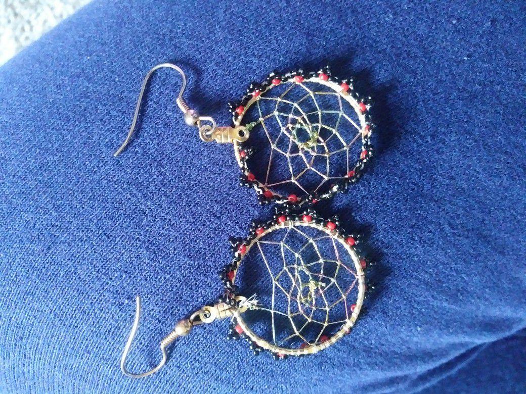 A pair of dream catcher earrings
