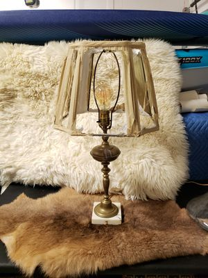 Photo Vintage brass lamp with shredded lampshade and marble base. Oxidization naturally occurring on the lamp. Edison bulb. 23 in tall 12 wide. $80