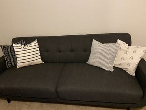Photo Sofa with pillows and rug for sale